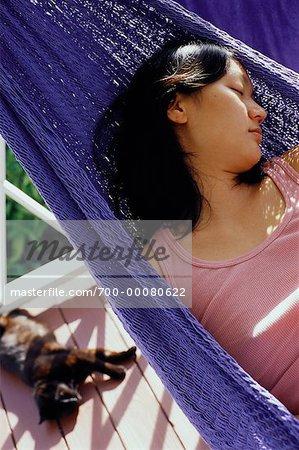 Woman Sleeping in Hammock on Porch Nevis, West Indies