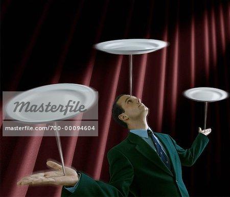 Businessman Balancing Plates