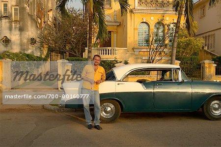 Man Leaning on Classic Car Havana, Cuba