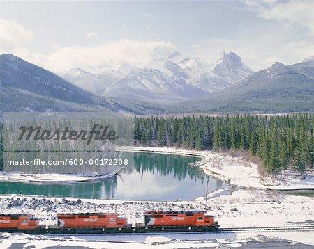 Train by Mount Lougheed and Bow River, near Dead Mans Flats, Alberta, Canada