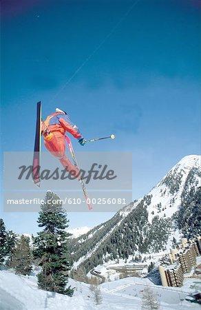France, Alps, La Plagne, jumping skier