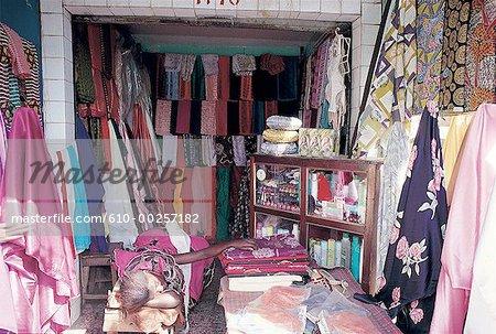 Senegal, Sine-Saloum, Kaolack, seamstress stand at market