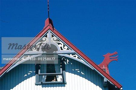 Denmark, Faroe Islands, Tòrshavn, dragon sculpted on a gable's house