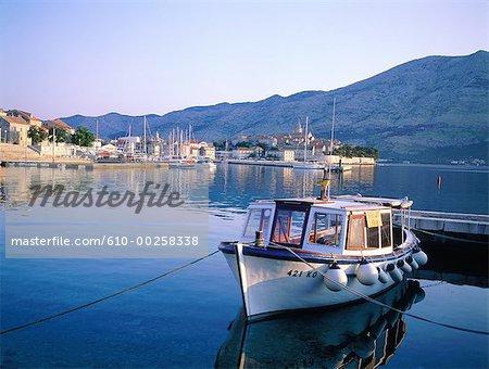 Croatia, Korcula Island, fishing boat and the ramparts at sunrise