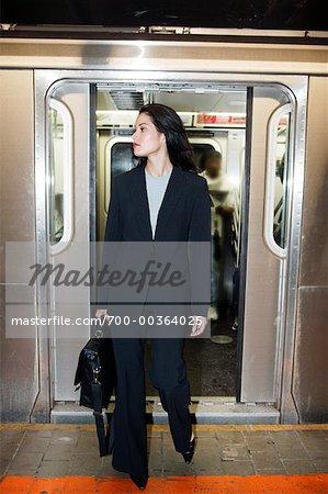 Woman Exiting Subway Car New York City, New York USA