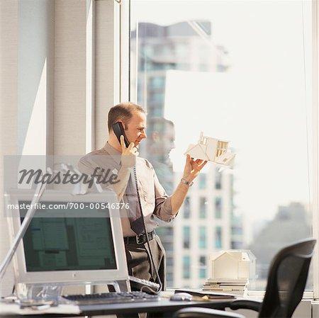 Businessman Looking at Model