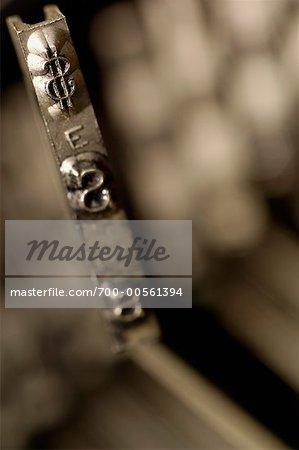 Close Up of Dollar Sign on Antique Typewriter