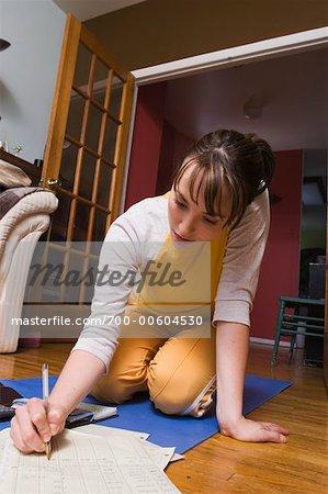 Woman Writing on Floor