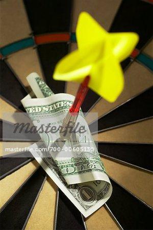 Dart Pinning Dollar Bill to Dartboard