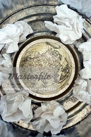 Globe in Trash Can