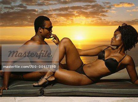 Couple laying on Beach