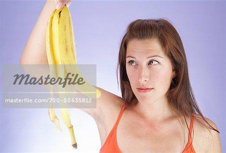 Woman Looking at Banana Peel