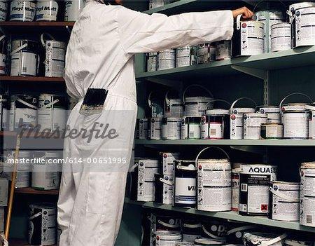 Janitor in paint cupboard