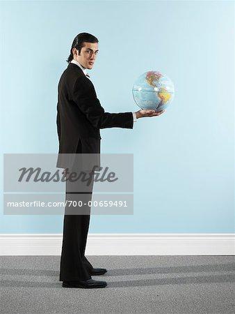 Portrait of Businessman Holding Globe