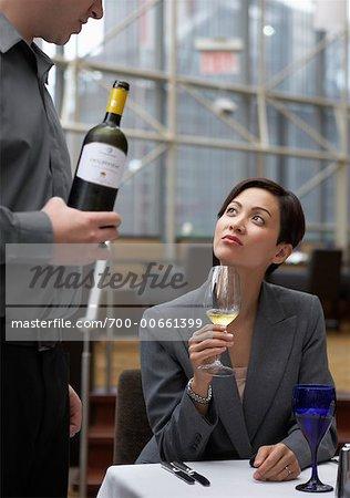 Woman Tasting Wine In Restaurant