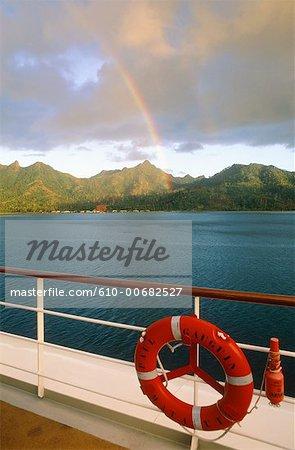 French Polynesia, Leeward Islands, rainbow at Huahine pass