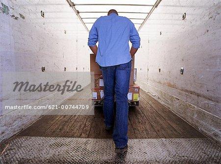Laborer at loading dock
