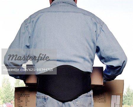 Worker wearing back support belt