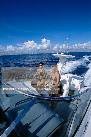 Women In Bikinis In Cruising Boat, Fort Lauderdale, Florida