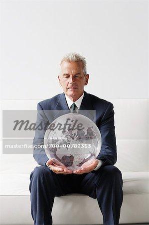 Mature Man Holding Globe