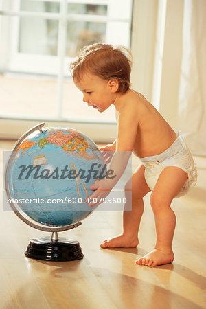 Boy Playing with Globe