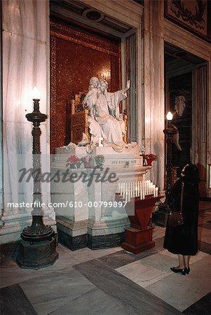 Italy, Rome, basilica of Santa Maria Maggiore, woman praying