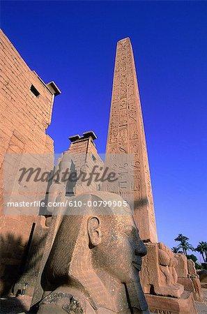Egypt, Luxor, obelisk and statue of Ramses II.