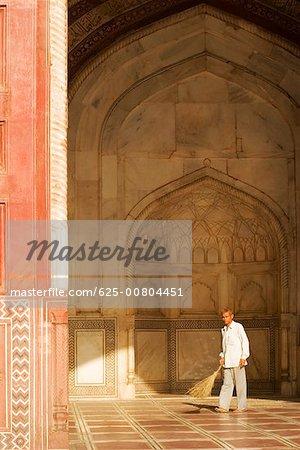 Portrait of a man standing in the Jawab Mosque, Agra, Uttar Pradesh India