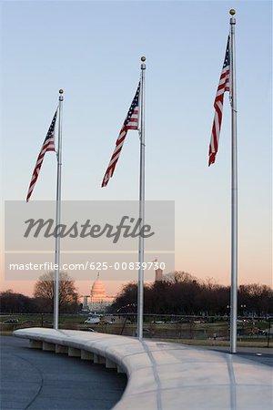 Low angle view of three American flags, Washington DC, USA