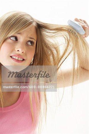 Girl Brushing Hair