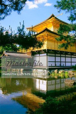 Reflection of a temple in water, Kinkaku-Ji Temple, Kyoto, Japan
