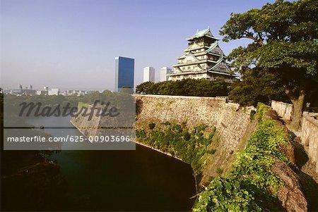 Castle along a moat, Osaka Castle Osaka, Japan