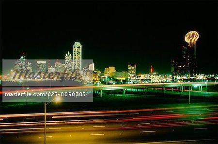 Buildings lit up at night, Dallas Texas, USA