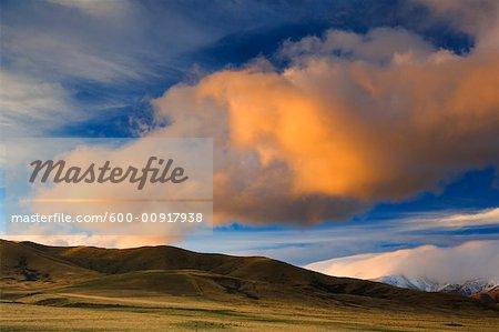 Nuage sur flanc de colline, Otago, South Island, Nouvelle-Zélande