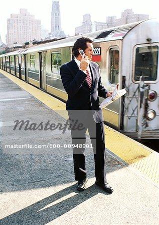 Businessman on Subway Platform, Talking on Cellular Phone