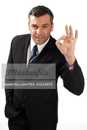Businessman Making OK Sign