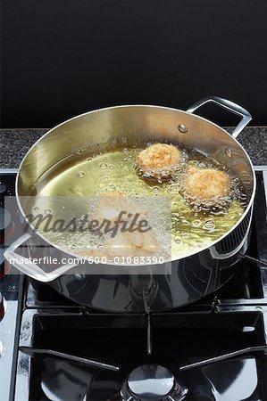 Saure Sahne Krapfen Kochen in Öl