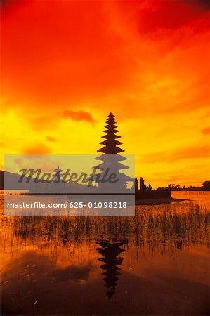 Reflection of a temple in water, Pura Ulu Danau Temple, Bali, Indonesia