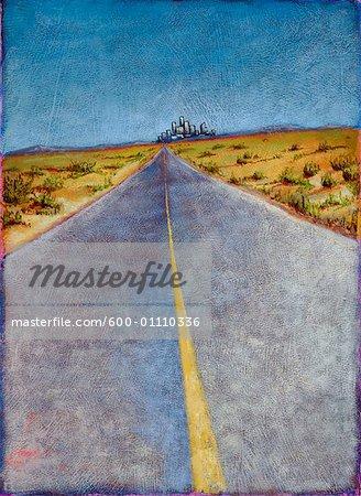 Route à travers paysage désert avec la ville au loin