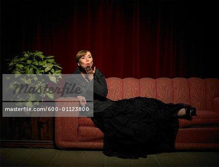 Woman on Sofa Blowing Kiss