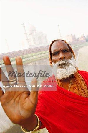 Portrait of a priest making a stop gesture, Taj Mahal, Agra, Uttar Pradesh, India
