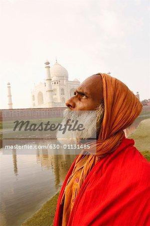 Side profile of a priest on the riverbank, Taj Mahal, Agra, Uttar Pradesh, India