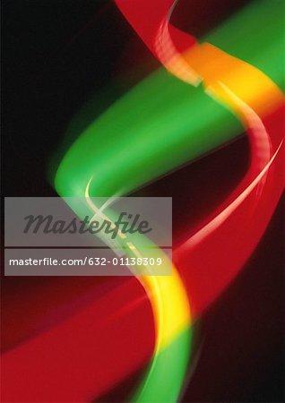 Effet de lumière en deux faisceaux de torsion, rouge, vert et jaune.