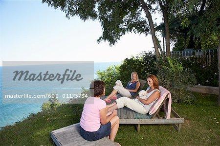 Women Sitting Outdoors