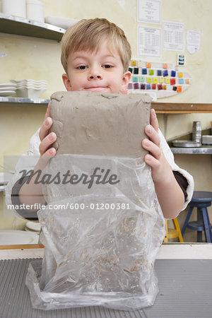 Portrait of Boy in Pottery Studio