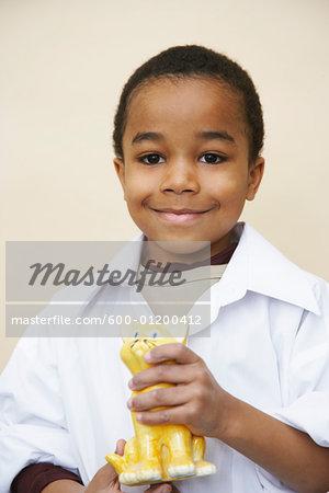 Portrait of Boy Holding Sculpture