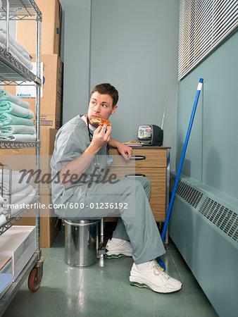 Doctor Taking a Break in Hospital Supply Room