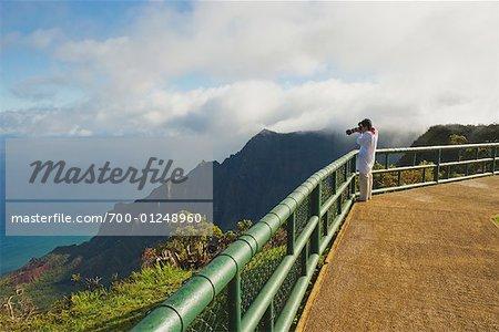 Woman Taking Photo at Kalalau Lookout, Kokee State Park, Kauai, Hawaii