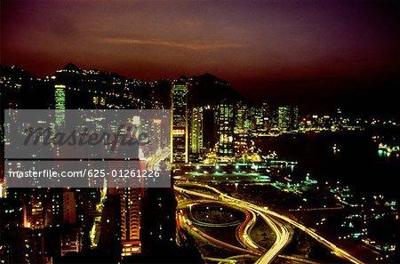High angle view of buildings lit up at night, Causeway Bay, Hong Kong, China