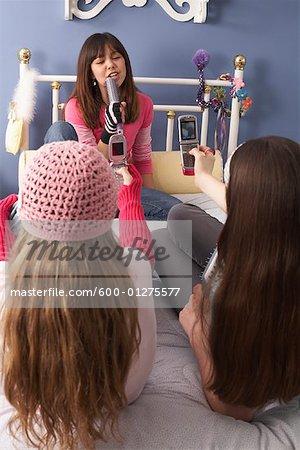 Girl Singing while Friends take Photos